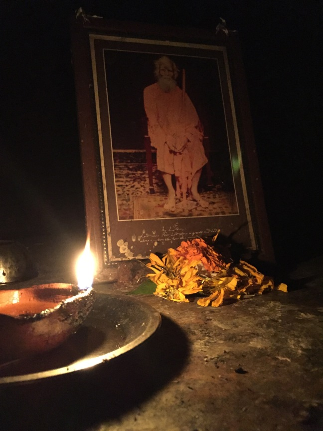 A small alter near the cave entrance. I do not know who the picture is of, but I suspect it is the swami that started the ashram here.