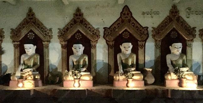Random, candlelit roadside Buddhas.
