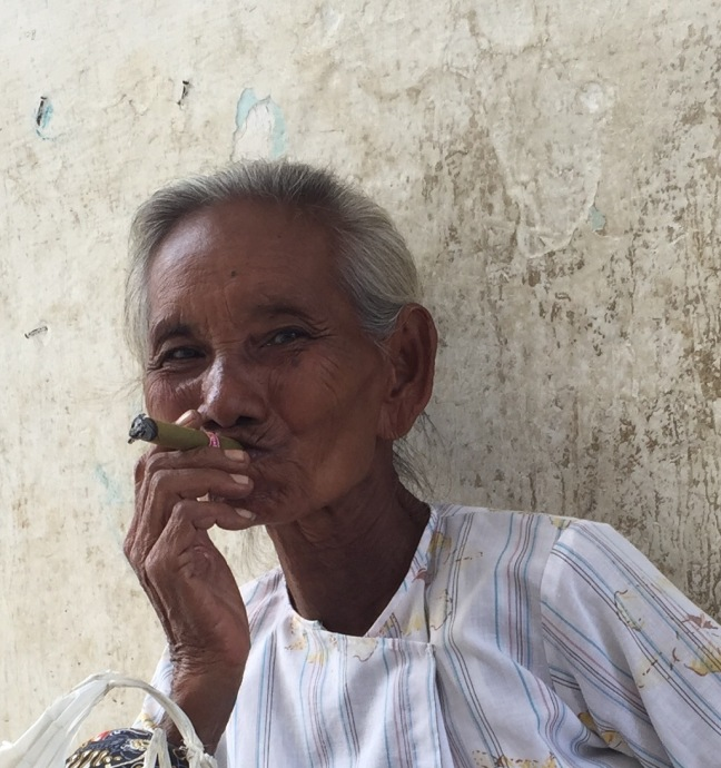This woman would not stop smiling at me. When I motioned about taking her picture she grinned and nodded and then stuck the big cigarette in her mouth for me. I think I love her.