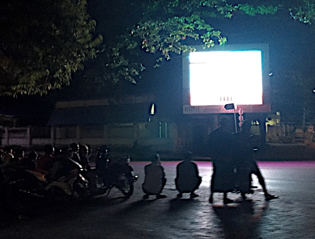 Locals stopped at a street side screen posting election results.
