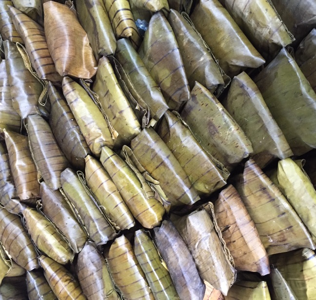 Rice-something or other wrapped in banana leaves.