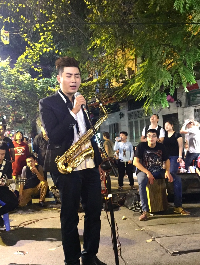 Emo street musician. Every night of the week, on multiple corners of blocked off streets in the Old Quarter, performances were being given. Jazz, traditional Vietnamese dance, accordian duet, you name it. Always a crowd, always entertaining.