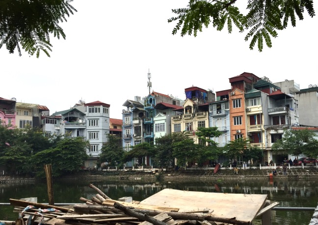 Typical housing... tight four story buildings nestled together, looking down on a river front where people walk, fish or just chill.
