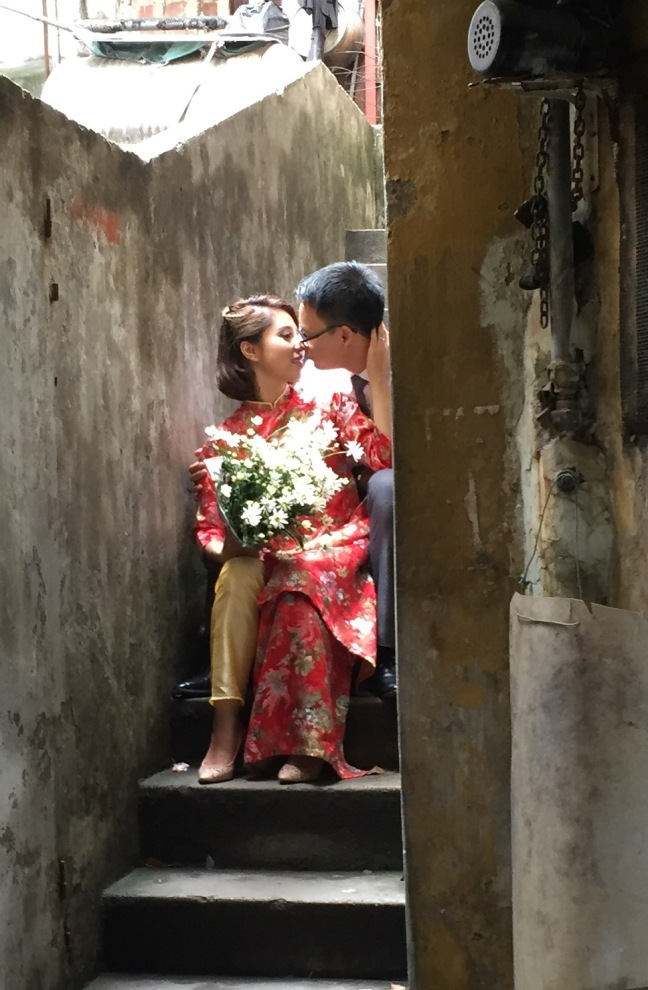 I stumbled upon this in one such hidden alleyway. Engagement photo, I assume? They are big on formal photography for every major life event here.