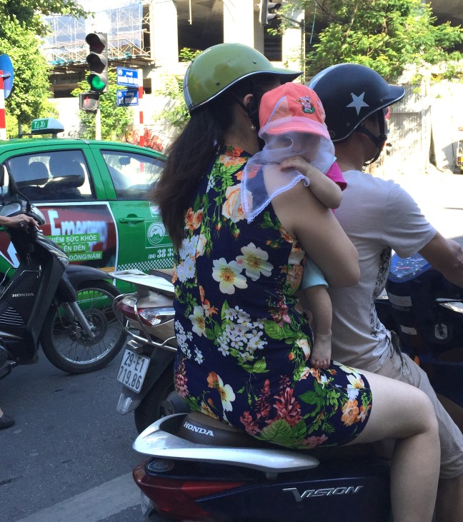Babies on scooters.