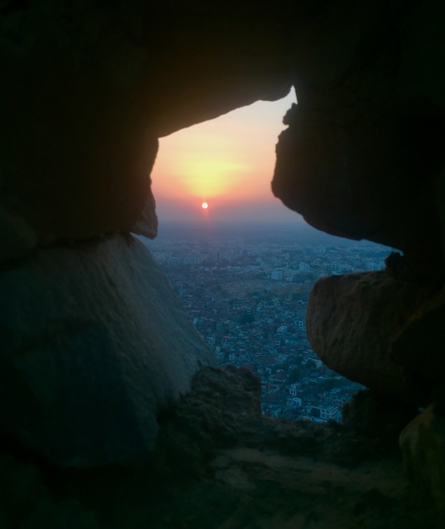 Sunset over Jaipur seen through the fort wall