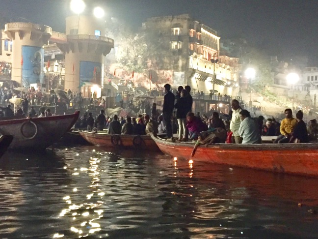 Boats parked along the ghats, enjoying the show