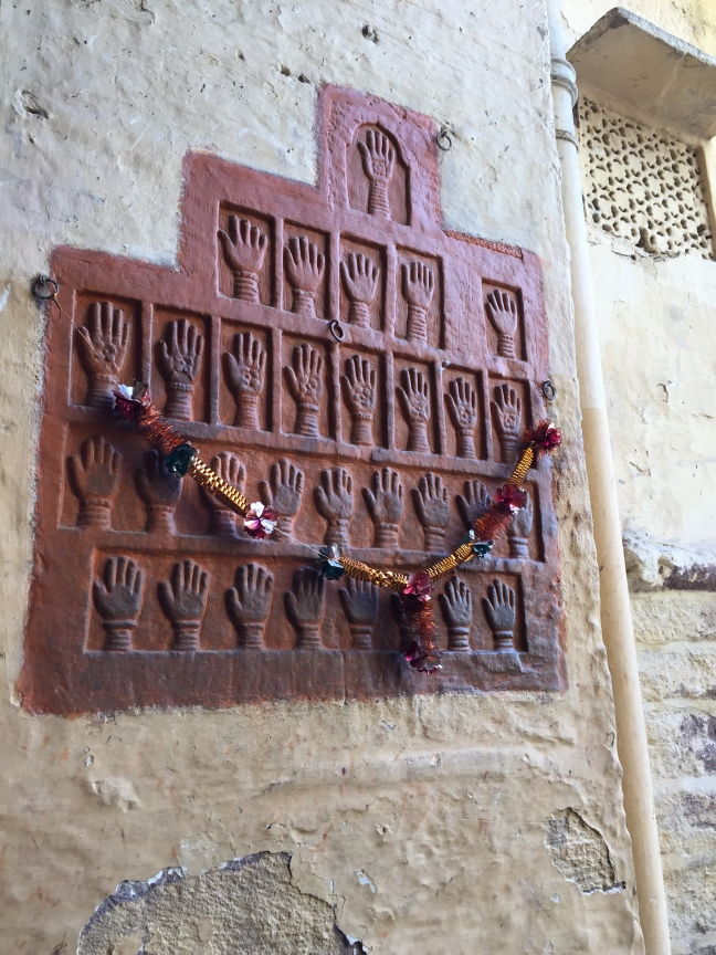 The infamous Handprints of Sati, outside Mehrangarh Fort. Sati was the ancient custom where widowed wives (and concubines) cast themselves upon their deceased husbands funeral pyre out of love and devotion.